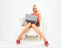 Girl in pink dress with laptop Royalty Free Stock Images