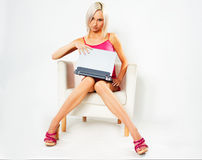 Girl in pink dress with laptop Royalty Free Stock Image
