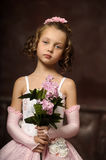 Girl in a pink dress with lilac in the hands Stock Image
