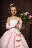 Girl in a pink dress with lilac in the hands Stock Photos