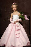 Girl in a pink dress with lilac in the hands Royalty Free Stock Photos