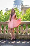 Girl in pink dress near the Eiffel tower in Paris Royalty Free Stock Photography