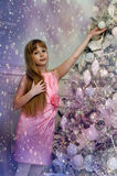 Girl in a pink dress near the tree Stock Photo