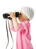 Girl in  pink dress with a pair of binoculars Stock Photography