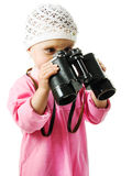 Girl in  pink dress with a pair of binoculars Royalty Free Stock Images