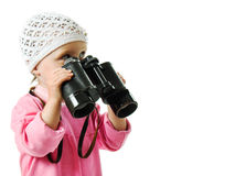 Girl in  pink dress with a pair of binoculars Royalty Free Stock Photo