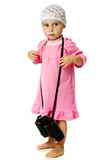 Girl in  pink dress with a pair of binoculars Stock Image