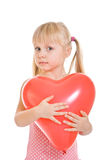 Girl in pink dress and with red balloon Stock Images