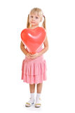 Girl in pink dress and with redballoon Stock Photography