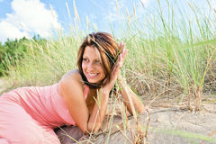 Girl in pink dress on seacoast Stock Photography