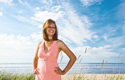 Girl in pink dress on seacoast Stock Photo