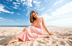 Girl in pink dress on seacoast Royalty Free Stock Photos