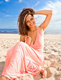Girl in pink dress on seacoast Stock Image