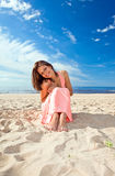 Girl in pink dress on seacoast Royalty Free Stock Image