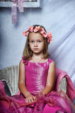 Girl in a pink dress. Sits Royalty Free Stock Photography