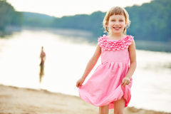 Girl in pink dress in summer Royalty Free Stock Images
