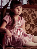 Girl in pink dress in vintage style Stock Image