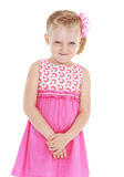 Girl in pink dress on white background Stock Photos