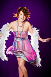 Girl with pink dress and white boa Royalty Free Stock Images