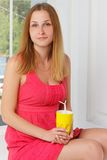 Girl in a pink dress with yellow glass hand at Royalty Free Stock Photos