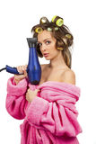 Girl in pink dressing gown with blue hairdryer Royalty Free Stock Photo