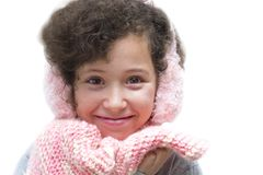 Girl with pink earmuff and pink scarf stock photography