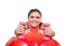 Girl in pink exercising with weights Stock Photo