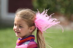 Girl with pink feathers in hair Royalty Free Stock Images