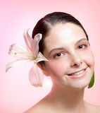 Girl with pink flower on hair Royalty Free Stock Photos