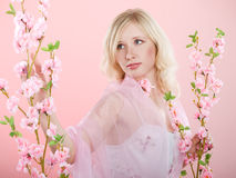 Girl with pink flowers Stock Photos