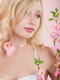 Girl with pink flowers Stock Photography
