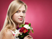 Girl with pink flowers Stock Photo