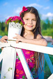 Girl with pink flowers in summer Stock Image