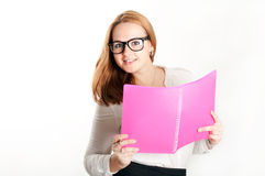 Girl with a pink folder on light background Stock Photo