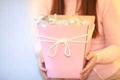 A girl with pink gift box and lights stock photo