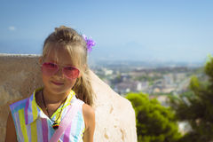The girl in the pink glasses, the castle Santa Barbara Stock Images