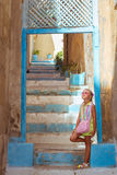 Girl in pink glasses standing on stairs, Alicante Royalty Free Stock Image
