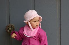 Girl in pink by the gray wall Royalty Free Stock Photography