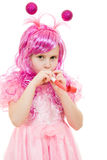 A girl with pink hair  blowing a whistle Royalty Free Stock Photos