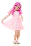 A girl with pink hair in a pink dress Stock Photos