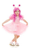 A girl with pink hair in a pink dress dancing Stock Photos