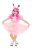 A girl with pink hair in a pink dress dancing Stock Photo