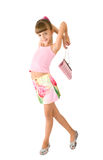 The girl with a pink handbag. Is photographed on the white background Royalty Free Stock Photography