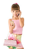 The girl with a pink handbag. And mobile is photographed on the white background Royalty Free Stock Images