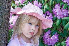 Girl with pink hat Stock Image