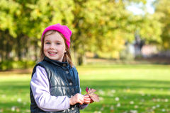 Girl with a pink hat on Stock Image