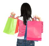 Girl in pink holding shopping bags Royalty Free Stock Photo
