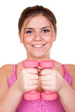Girl in pink holding weight for exercise Royalty Free Stock Images