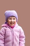 Girl in pink jacket and hat Royalty Free Stock Photography