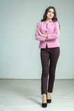 Girl in a pink jacket. Portrait of a girl in a pink jacket and pants delicious Stock Photos